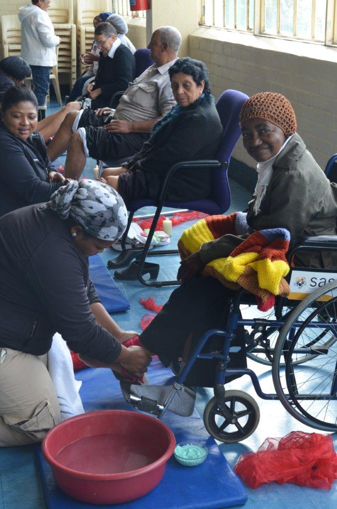 Team Tintswalo giving foot massages to the seniors